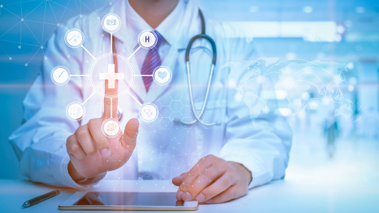 Close up of Doctor is touching digital virtual screen for analytics Medical data , Medical technology concept