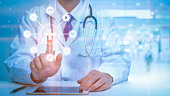 istock Close up of Doctor is touching digital virtual screen for analytics Medical data , Medical technology concept 1273886962