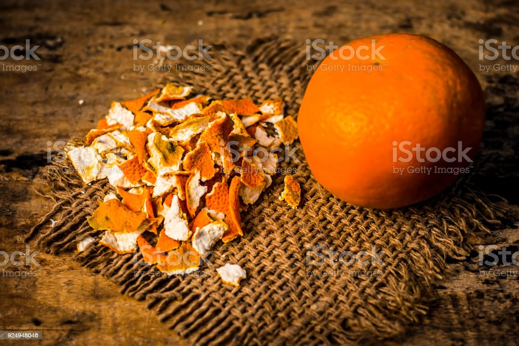 Close up of dried peel of orange,Citrus aurantium on a gunny background used as a face pack and for skin care. stock photo