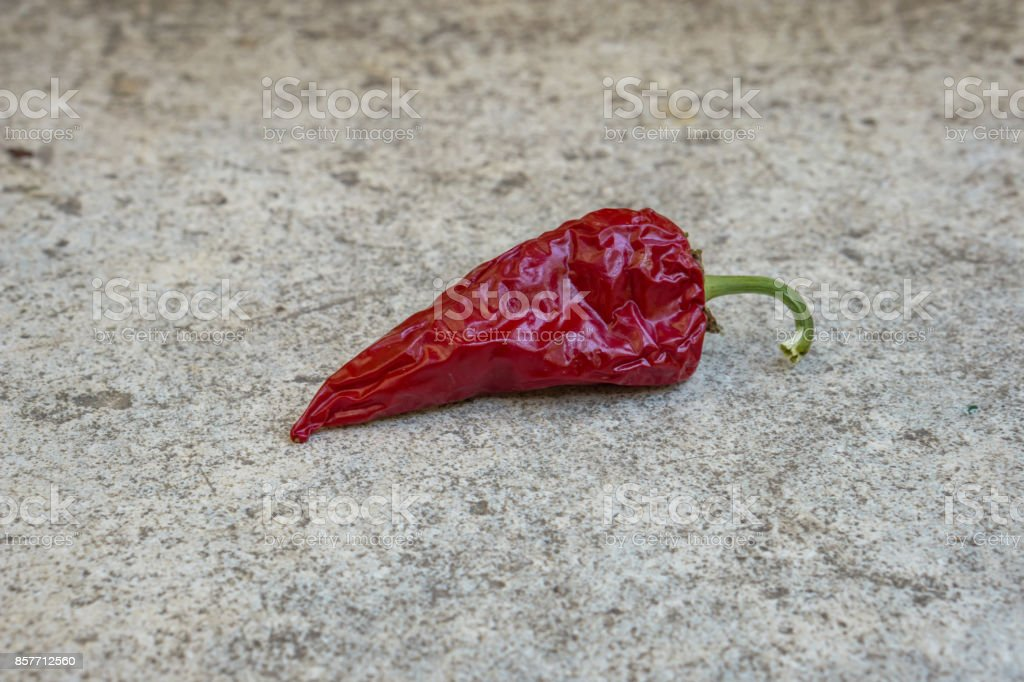 Close up of dried red peppers, stone background. Concept village, nostalgia. Shallow depth of focus. Copy space. stock photo