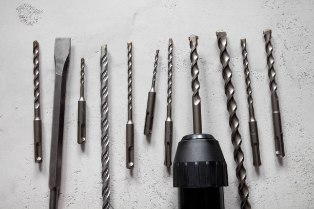 Close up of drill bits on concrete background stock photo