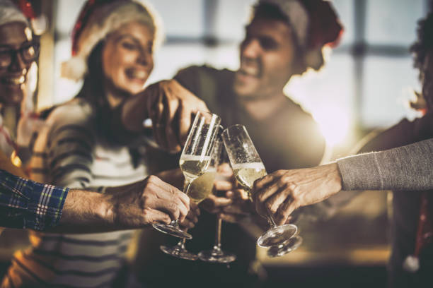 close up of drinking champagne on new year's party. - office party stock pictures, royalty-free photos & images