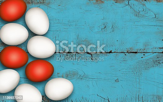 922843504 istock photo Close up of easter eggs on blue brushed wooden background. Rustic colored background, decoration. Red and white Easter eggs on a wooden table. Invitation template design, greeting card, place for text 1139937043