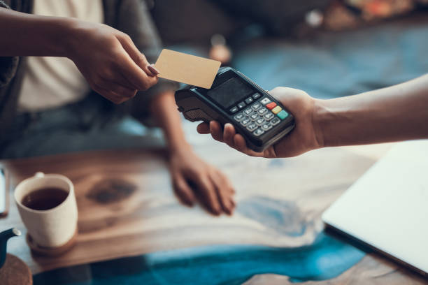 Close up of easy payment by credit card indoors stock photo