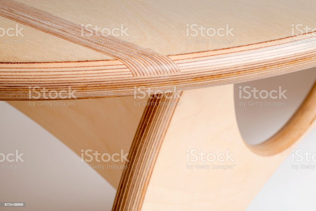 Close Up of Edge of Round Table Displaying Intricate Woodworking stock photo