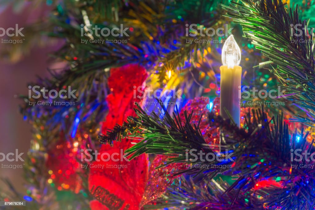 Close Up Of Electric Candles As Decoration On The Christmas Tree
