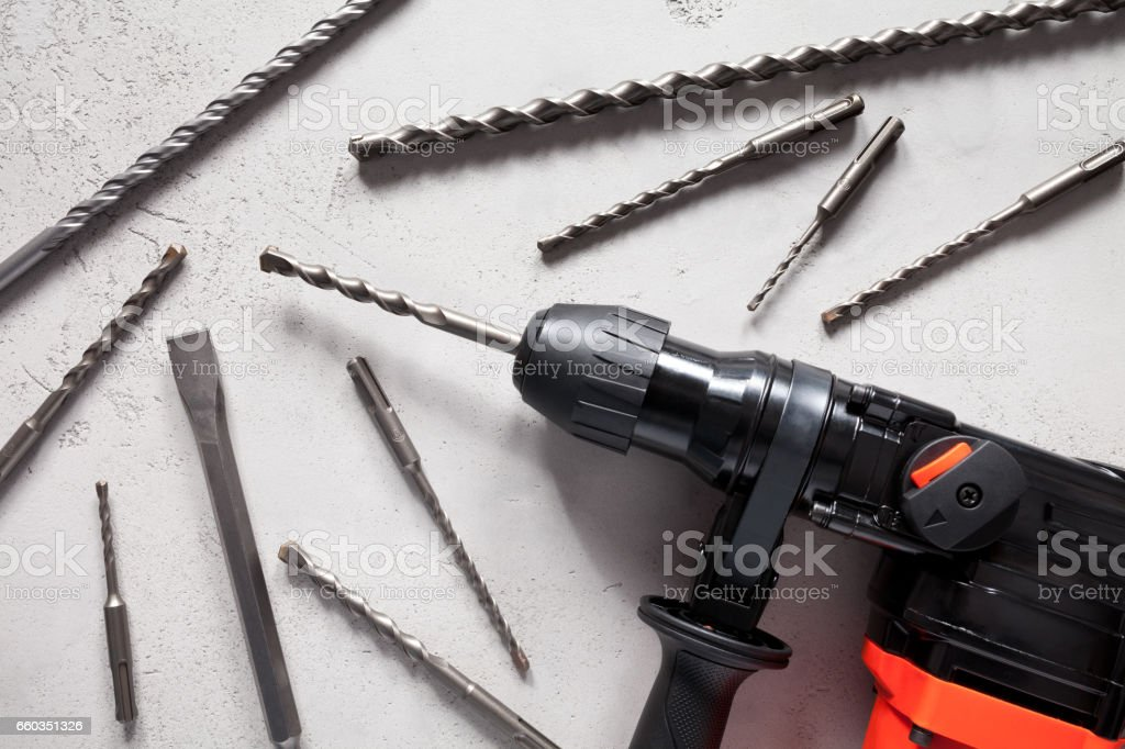Close up of electric drill on concrete background stock photo