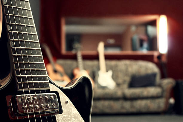 Close up of electric guitar in a studio stock photo