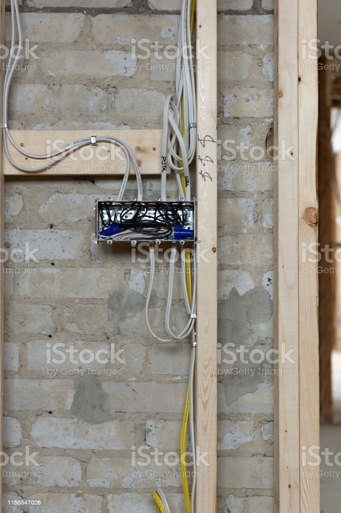 Close Up Of Electrical Wires Connected Into A Metal Box In A ... on