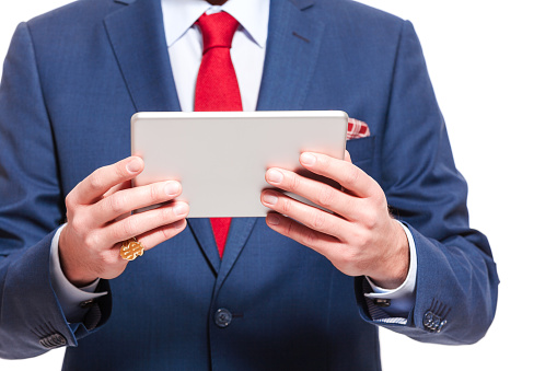 Close Up Of Elegant Businessman Wearing Suit Holding Digital Tablet Stock Photo - Download Image Now