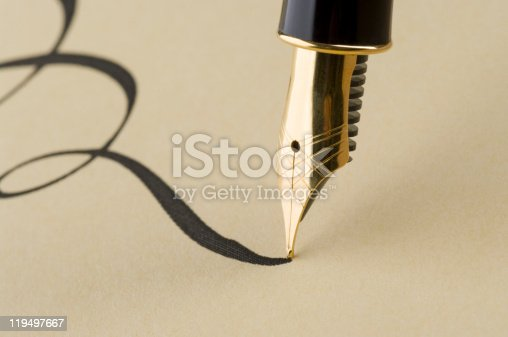 istock Close up of elegant calligraphy with gold pen 119497667