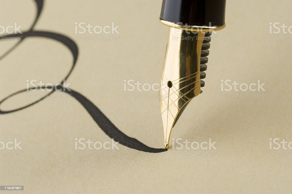 Close up of elegant calligraphy with gold pen stock photo
