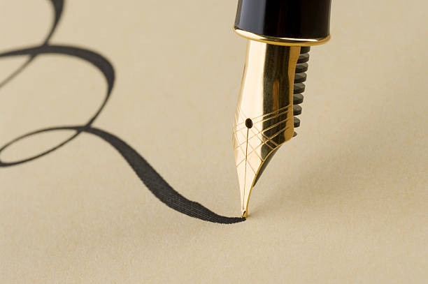 close up of elegant calligraphy with gold pen - calligraphy stock photos and pictures