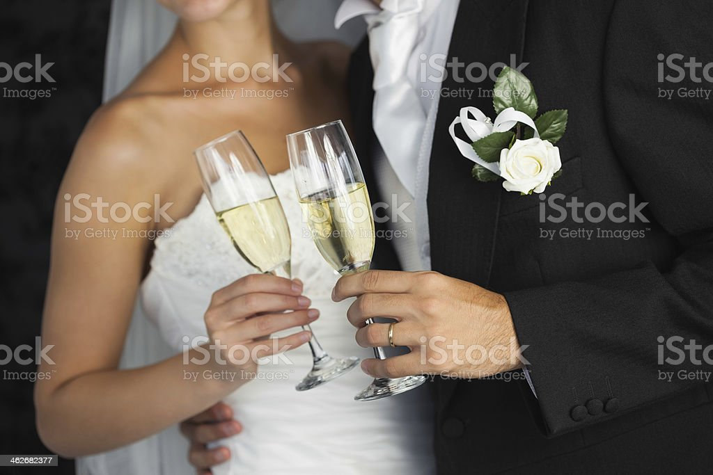 Close up of elegant young newlyweds toasting with champagne stock photo
