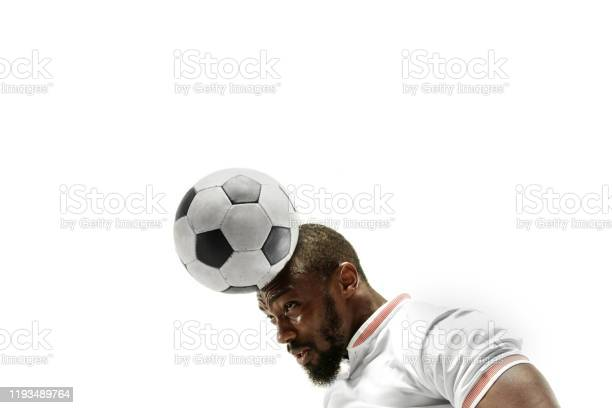 Close up of emotional man playing soccer hitting the ball with the picture id1193489764?b=1&k=6&m=1193489764&s=612x612&h=rf7rbcp1ubwx9g8qoptwkegzvdsc7qurwhtefqgkdfo=