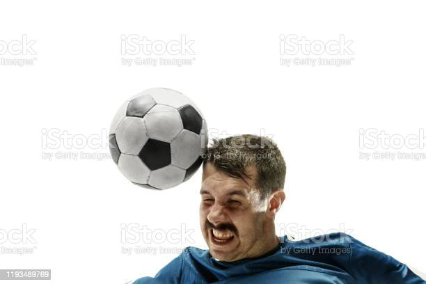 Close up of emotional man playing soccer hitting the ball with the picture id1193489769?b=1&k=6&m=1193489769&s=612x612&h=iliwsdpildqixbhhvqjcuosblnvnic2xemwkqqb1 o8=