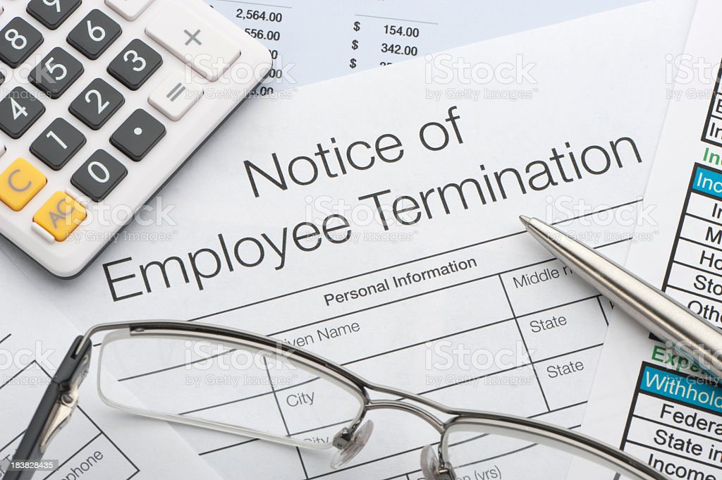 Close up of Employee termination form Close up of Employee termination form with pen and calculator Agreement Stock Photo