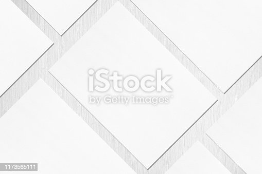 1171907064 istock photo Close up of empty white rectangle poster or card mockups lying diagonally on light grey textured background 1173565111