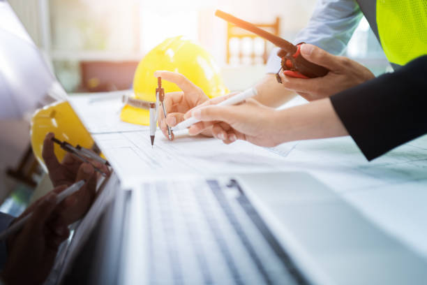 close up of engineer hand drawing plan a construction project - civil engineering stock pictures, royalty-free photos & images