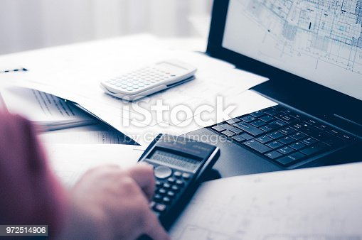 638881988istockphoto Close up of engineers hands working on table, he drawing project sketch in construction site or office 972514906