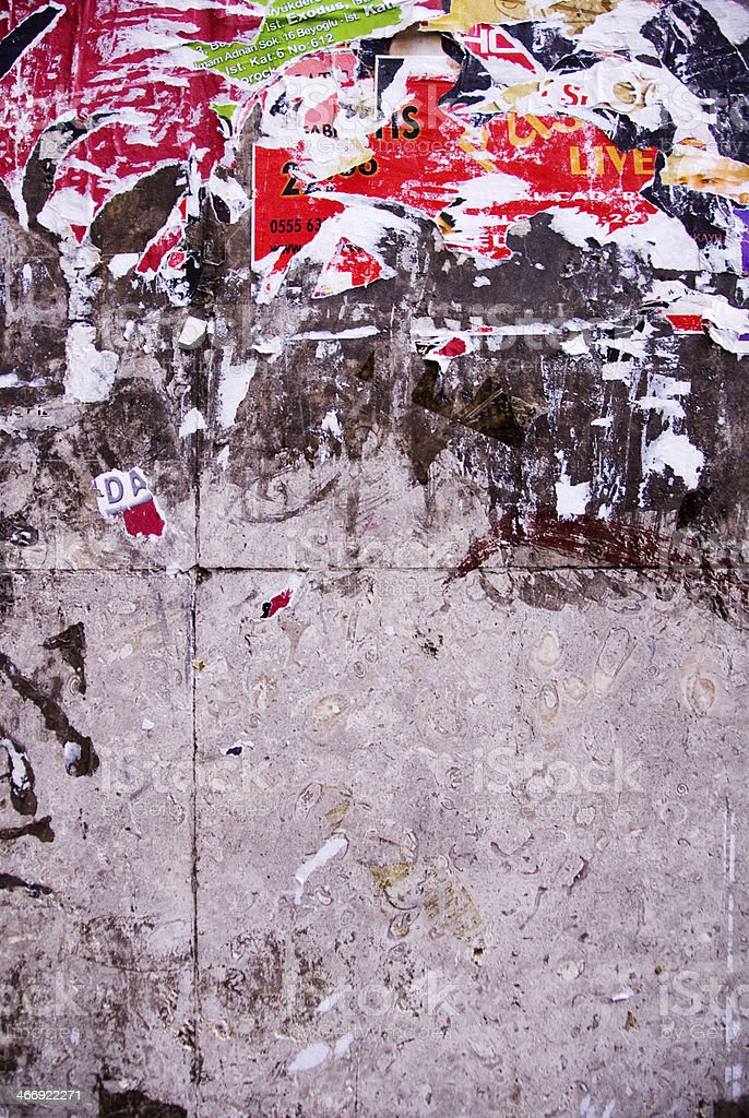 Close up of entertainment event posters torn off a wall royalty-free stock photo