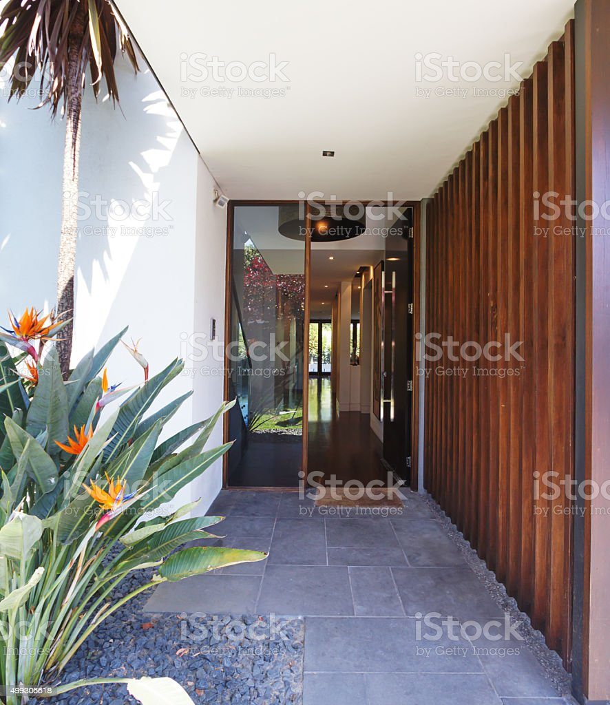Close up of entry paving and front door luxury home stock photo