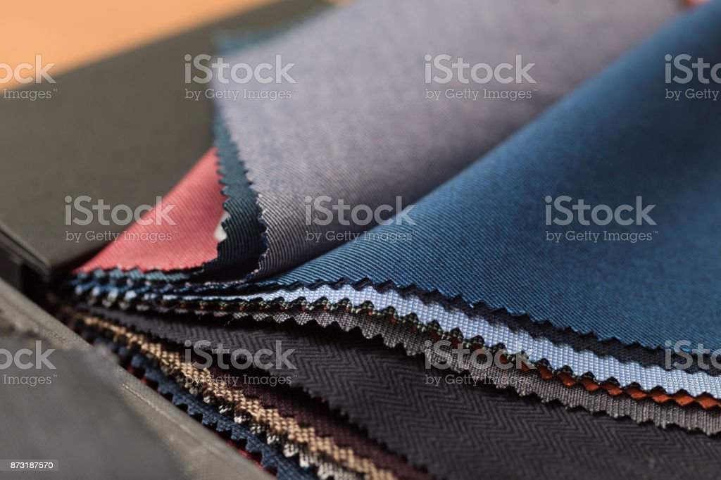 Close up of fabric swatch book with various wools. stock photo
