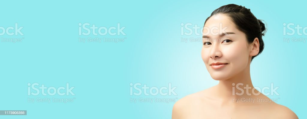 Close Up Of Face Asian Woman With Clean Fresh Skin Look Girl Beauty Face Care Facial Treatment Cosmetology Beauty And Spa Isolated On Colorful Blue Banner Background Stock Photo Download Image