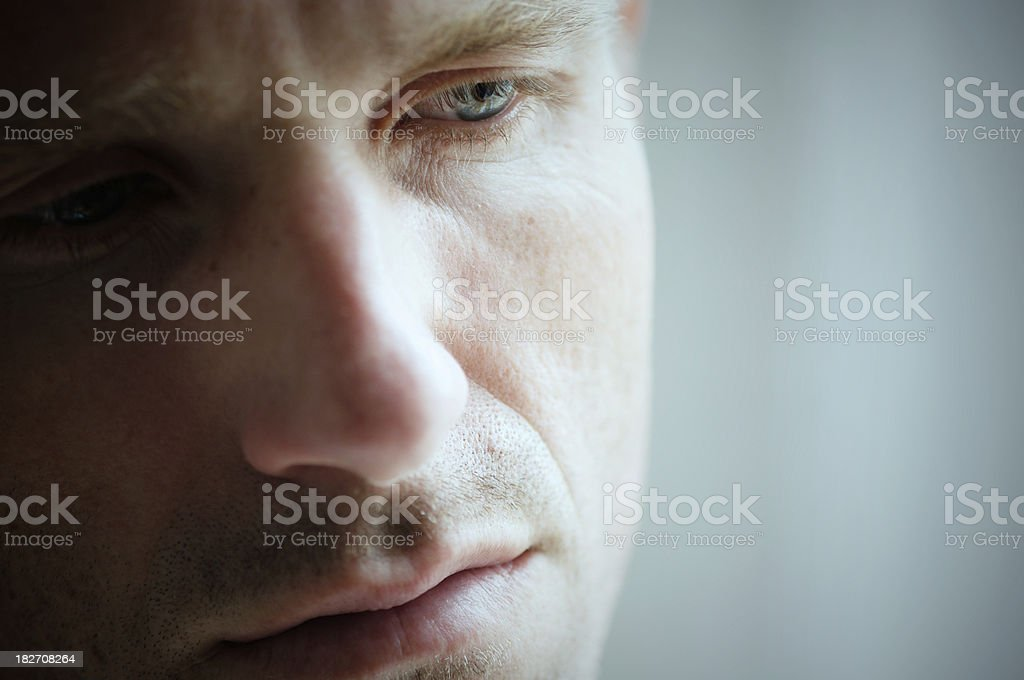 Close Up of Face Depressed Man Looking Down stock photo