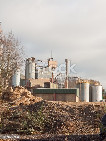 istock close up of factory industry buildings at sand quarry in essex wivenhoe 887577720