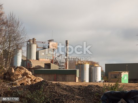 istock close up of factory industry buildings at sand quarry in essex wivenhoe 887577732