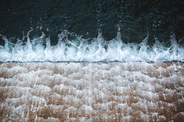 close up of falling water on barrage - hydroelectric power stock photos and pictures