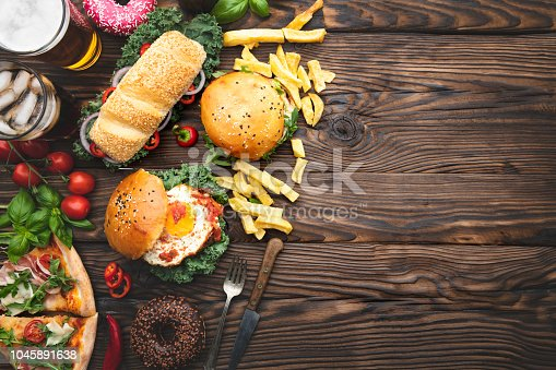 Top view of fast food snacks and drink on table with space on text