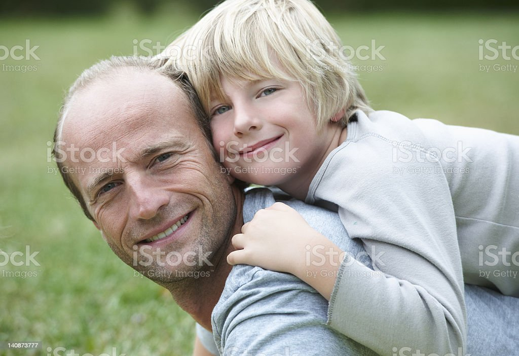Close up of father and son smiling stock photo
