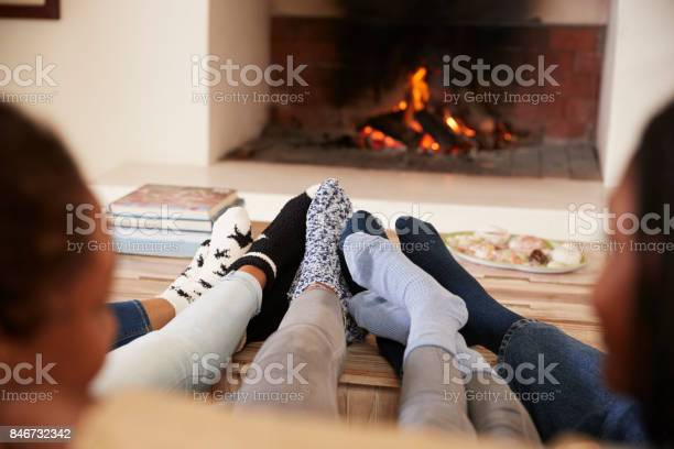 Close up of feet as family relax next to open fire picture id846732342?b=1&k=6&m=846732342&s=612x612&h=8 ytjnygc3btmembtlrl7bamfrftfpky gn2jzy3e g=
