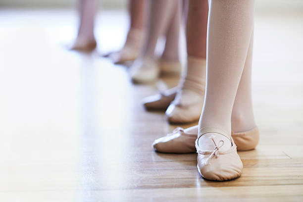 Close Up Of Feet In Children's Ballet Dancing Class stock photo