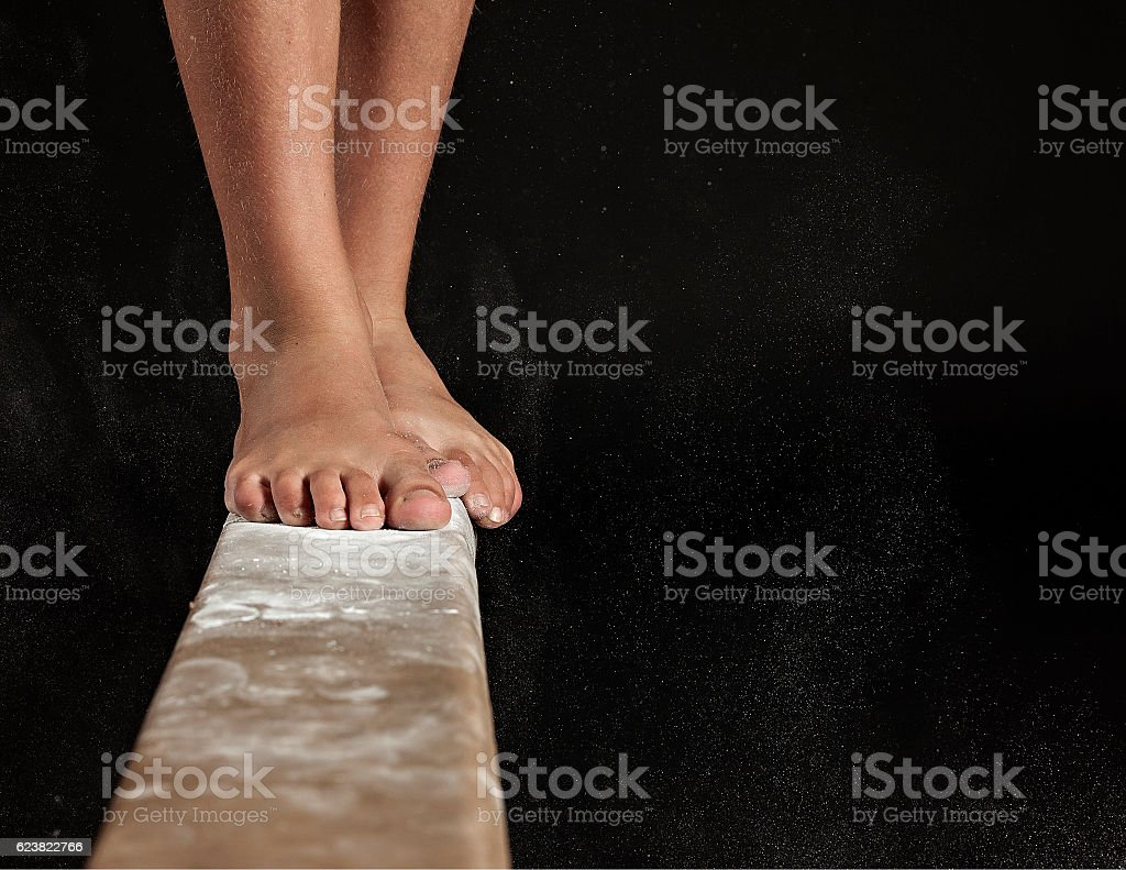 Close up of feet on Balance Beam stock photo