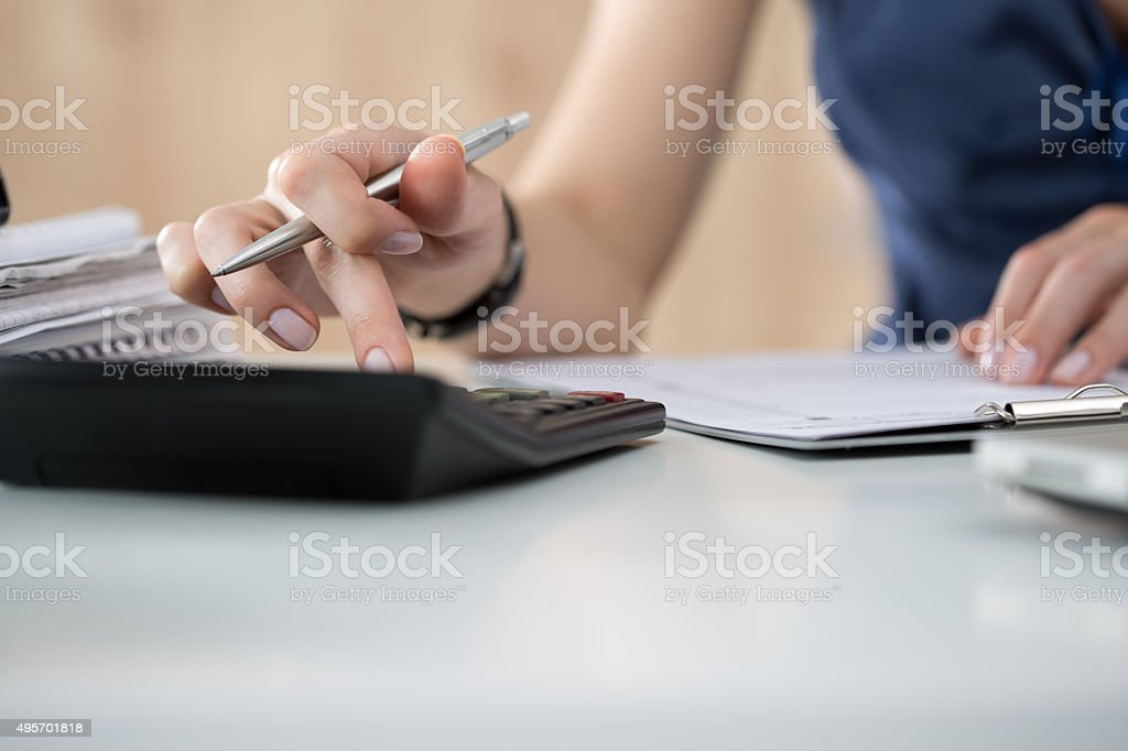 Close up of female accountant or banker making calculations royalty-free stock photo
