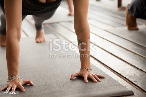 914755448istockphoto Close up of female arms in Plank pose 922344978