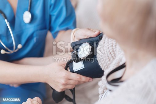 istock Close up of female doctor monitoring arterial blood pressure 868000988