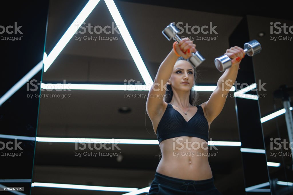Close up of female doing weight workout stock photo