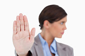 istock Close up of female entrepreneurs hand signalizing stop 824991004