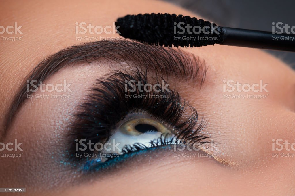 Close up of female eye with beautiful long lashes - Foto stock royalty-free di Adulto