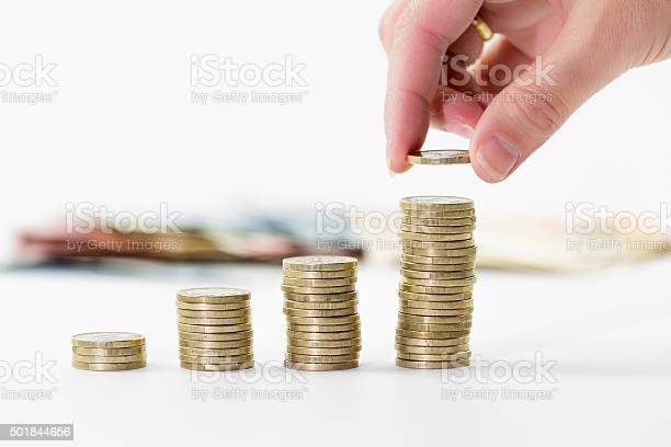Close Up Of Female Hand Stacking Euro Coins Stock Photo - Download Image Now