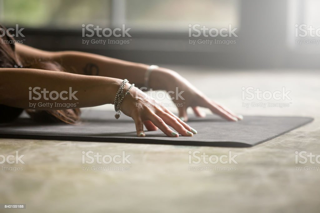 Close up of female hands, Child pose royalty-free stock photo