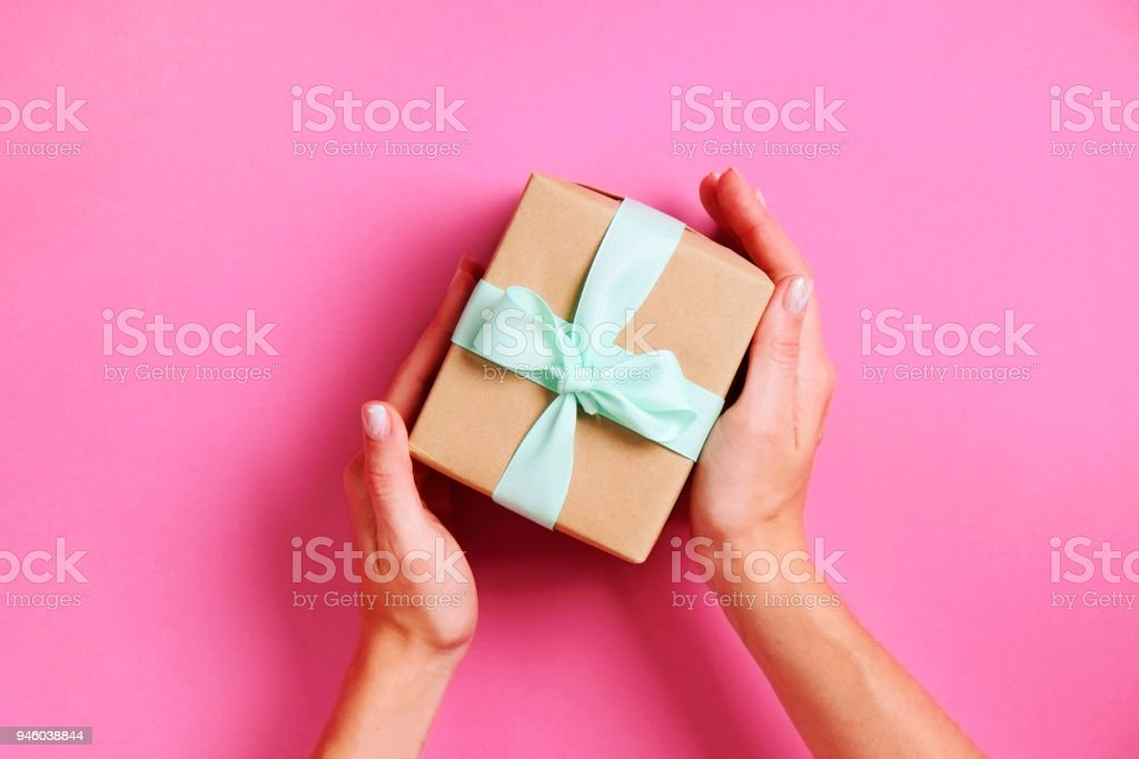 Close Up Of Female Hands Holding Birthday Gift In Vintage Craft
