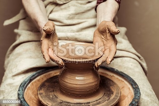 istock Close up of female hands working on potters wheel 685006564
