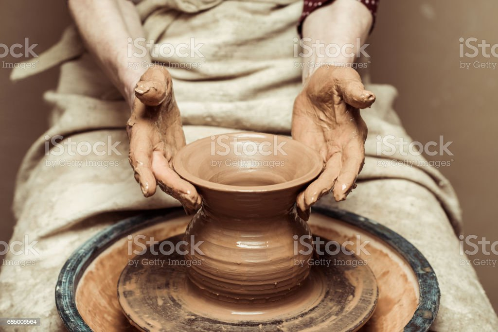 Close up of female hands working on potters wheel stock photo