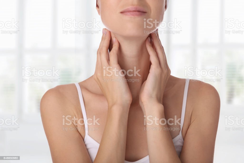 Close up of female neck and shoulders. Woman thyroid gland control. stock photo