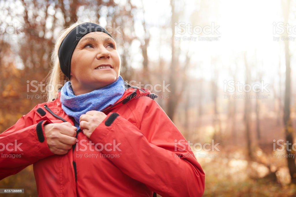 Close up of female senior runner outdoors stock photo